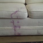 White Couch with red wine stains