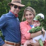 Family dressed up as the cast of Jurassic Park with the baby as a dinosaur