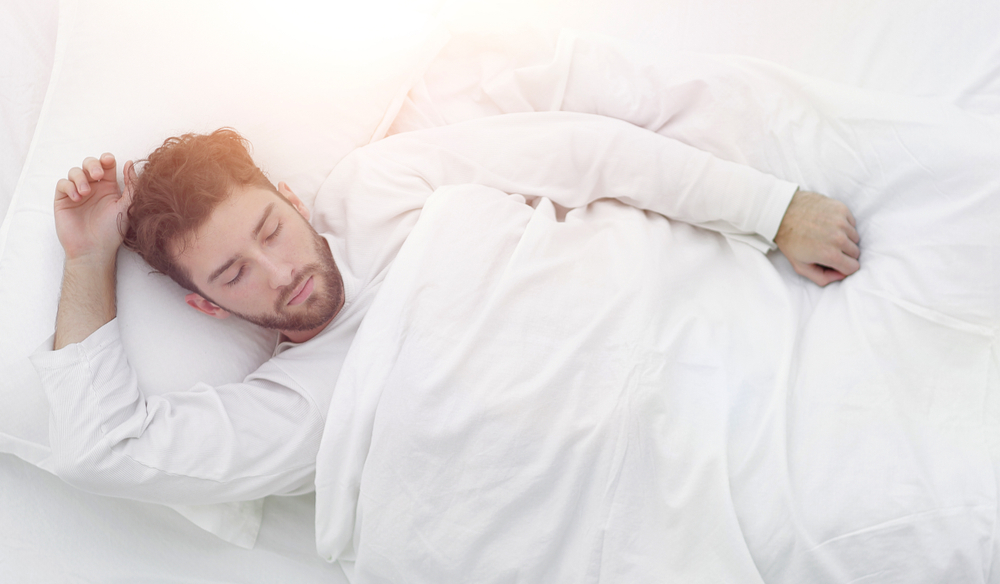 Man sleeping with a weighted blanket