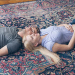 A couple lying on a persian rug