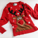 Ugly christmas sweater in need of dry cleaning. Here are dry cleaning services for the holiday season!