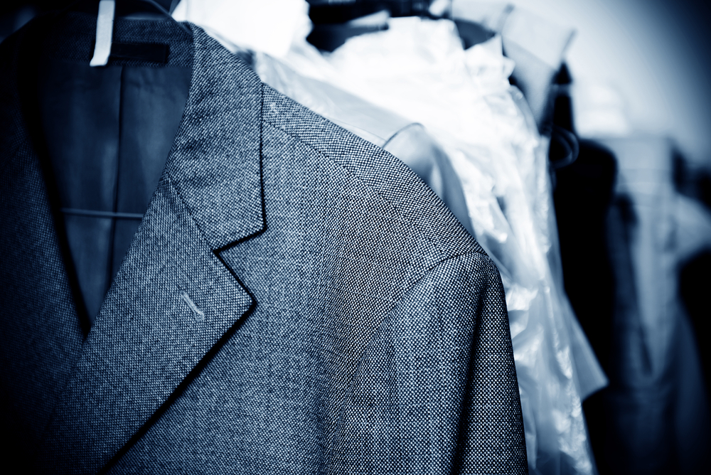 Suits on hangers for dry cleaning
