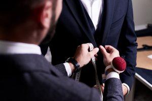 Over,Shoulder,View,Of,Bearded,Fashion,Designer,Fitting,Bespoke,Suit